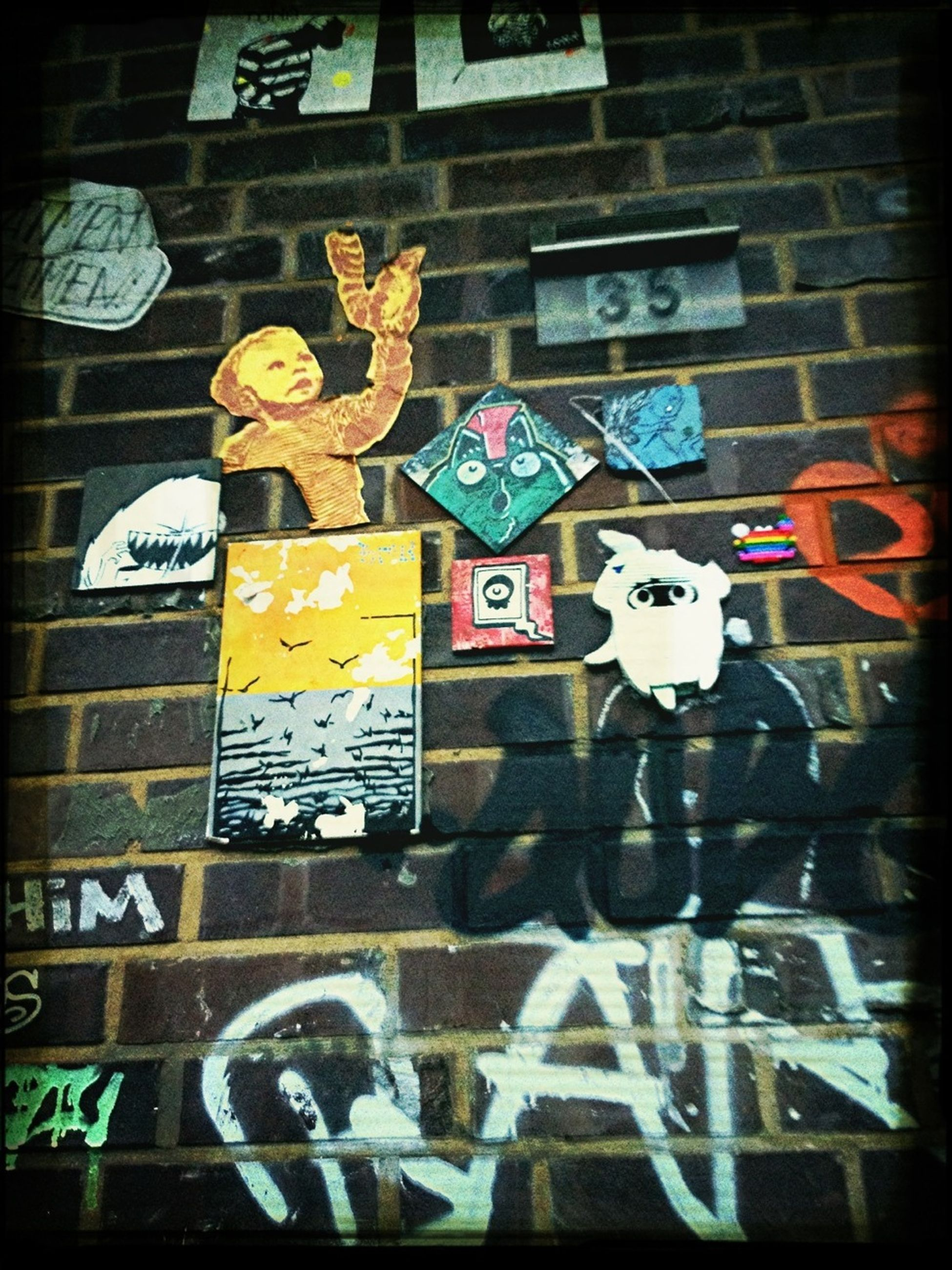 graffiti, text, western script, art, art and craft, communication, creativity, built structure, human representation, architecture, wall - building feature, transfer print, building exterior, street art, auto post production filter, non-western script, vandalism, capital letter, sign