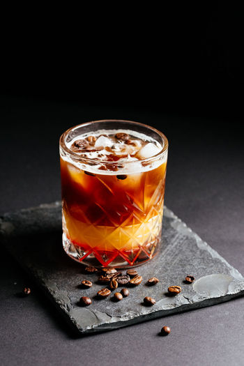 Close-up of coffee served on table against black background