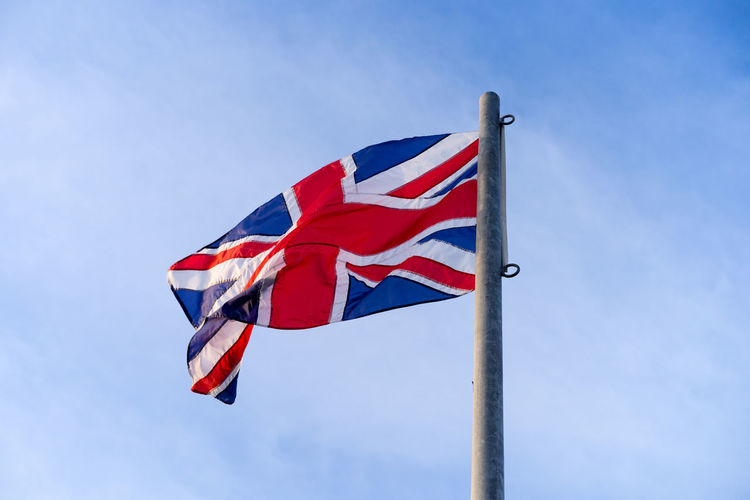 Union Jack of United Kingdom Ceremonial Northen Ireland Scotland Union United Kingdom Wales Blue England Flag Freedom Independence Low Angle View National Icon Outdoors Patriotism Pride Red Sky Union Flag Union Jack Waving Wind