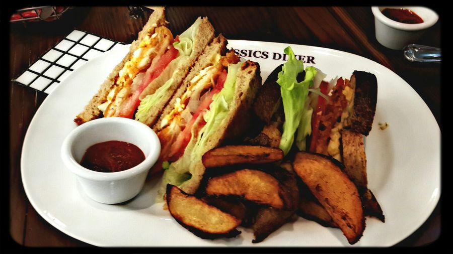 Fried fish sandwich with potato wedges Sandwich Potato Wedges In My Mouf Enjoying A Meal