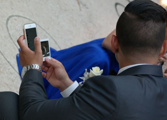 I crashed a prom in Vegas and this guy was proudly holding a Polaroid pic of him and his date. At least that is my story and I sticking to it. Technology and an old school Polaroid pic. The irony... Close-up Corsage Formal Hanging Out High School Hotel Lobby Las Vegas Las Vegas Hotel May 2016 Photos Photos Around You Polaroid Prom Prom Crasher Prom Date Prom Season Seniors Seniors 2016 Sitting Smart Phone Taking Photos Teenagers  Tuxedo Vegas  Wireless Technology