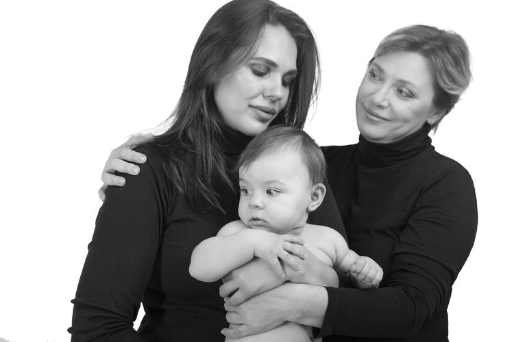 Happy mother and daughter against white background
