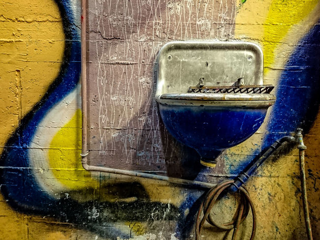 wash basin Architecture Basement Basin Blue Close-up Day Graffiti Indoor No People Unperfekthaus Wash Basin Water Hose Yellow Handy Photo