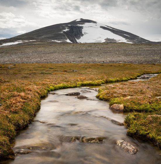Creek in a moor below the mountain Snøhetta, Norway. Water Nature Mountain Beauty In Nature Environment Tranquil Scene Landscape Tranquility Outdoors Flowing Water Flowing Snøhetta Norway River Creek Marsh Moored Highlands Wilderness Peak Glacier Dovre Dovrefjell Scenics EyeEmNewHere
