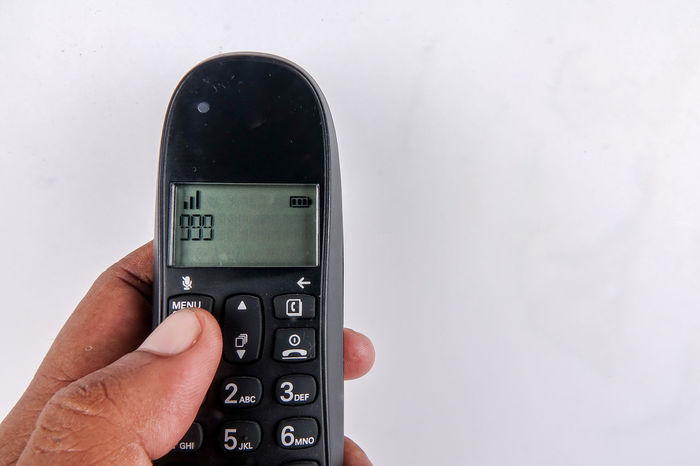 DIALING ON AN EMERGENCY NUMBER Close-up Day Dialing Dialing Code Emergency Number Handset Help Holding Human Body Part Human Hand Operator People Phone Technology
