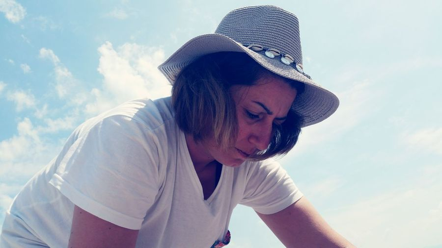 Low angle view of mature woman wearing hat