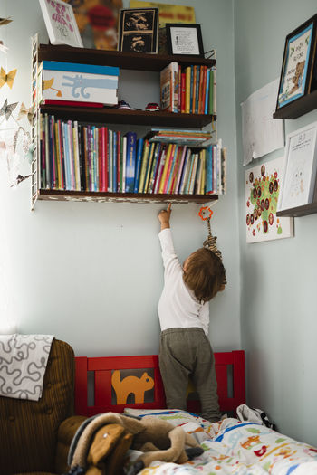 Rear view of boy standing at home