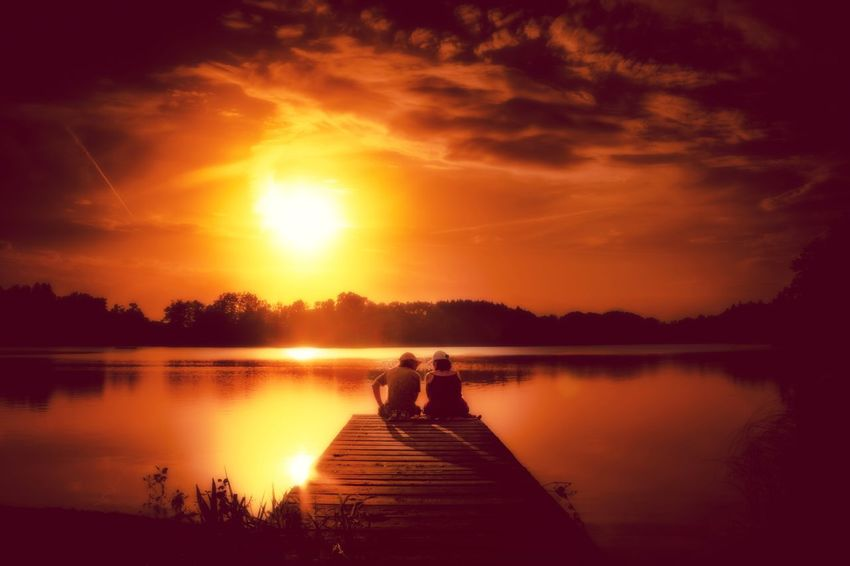 Sunset Reflection Lake Silhouette Togetherness Water Two People Tranquility Tree Sky Sun Men Adult Goodmorning EyeEm  Mysterious Goodnight Traveling Light And ShadowBeauty In Nature Outdoors Bonding People Nature Full Length Scenics