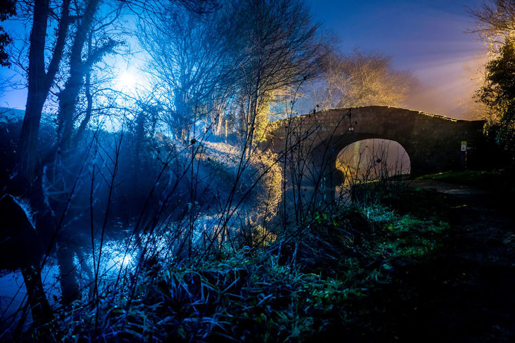 Welsh canal bridge at night Backlight Close Encounters Monmouthshire Monmouthshire Canal Night Photography Nightphotography Wales Arch Backlit Bare Tree Bridge - Man Made Structure Canal Connection Landscape Nature Night No People Outdoors Spooky Tree