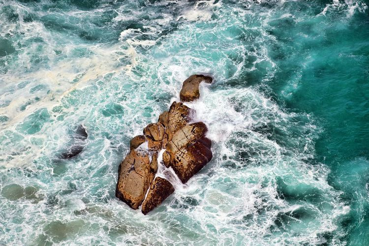 Sea Water Motion Wave Nature High Angle View Waterfront Rock - Object Beauty In Nature Flowing Water Solid Rock Splashing Outdoors Power In Nature Full Frame Background