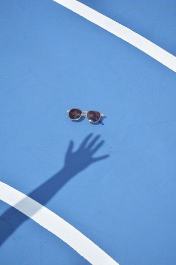 Sunglasses on blue ground