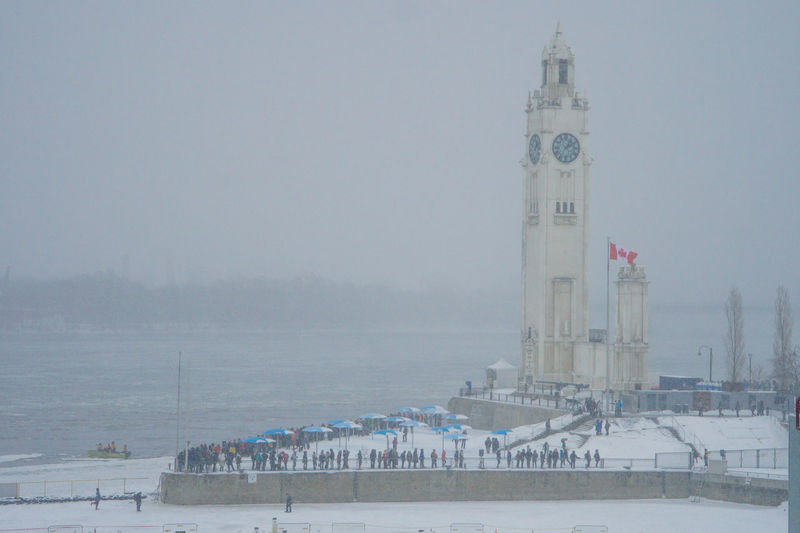 Canadian Canadian Flag City Clock Tower Cold Cold Temperature Crowd Old Port Old Port Of Montreal Old Port Of Montreal/Vieux-Port De Montréal Snow Snowy Urban Urban Photography Winter