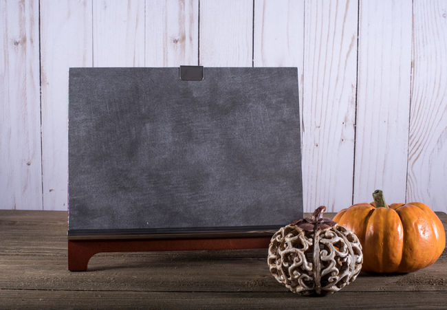 Blank Chalkboard with two pumpkins Autumn Text Thankgsiving Blackboard  Chalk Chalkboard Close-up Day Food Freshness Halloween Indoors  No People Pumpkin Table Vegetable Wood - Material