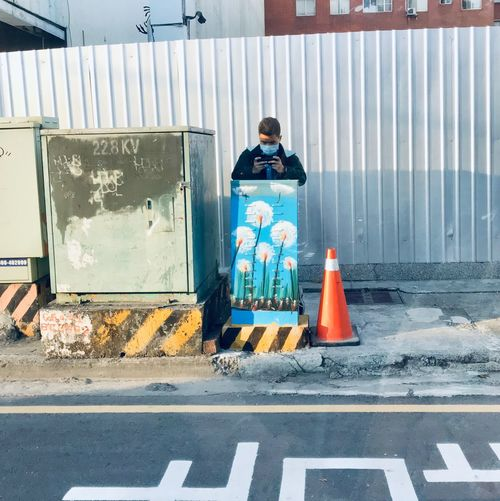 Paparazzi Photographer Paparazzi Candid Camera Streetphotography Person Using Mobile Taiwan ShotOnIphone Road City Sign Transportation Safety Security Street Architecture Real People Communication Outdoors Road Marking Day Full Length Cone Traffic Cone Protection People Standing