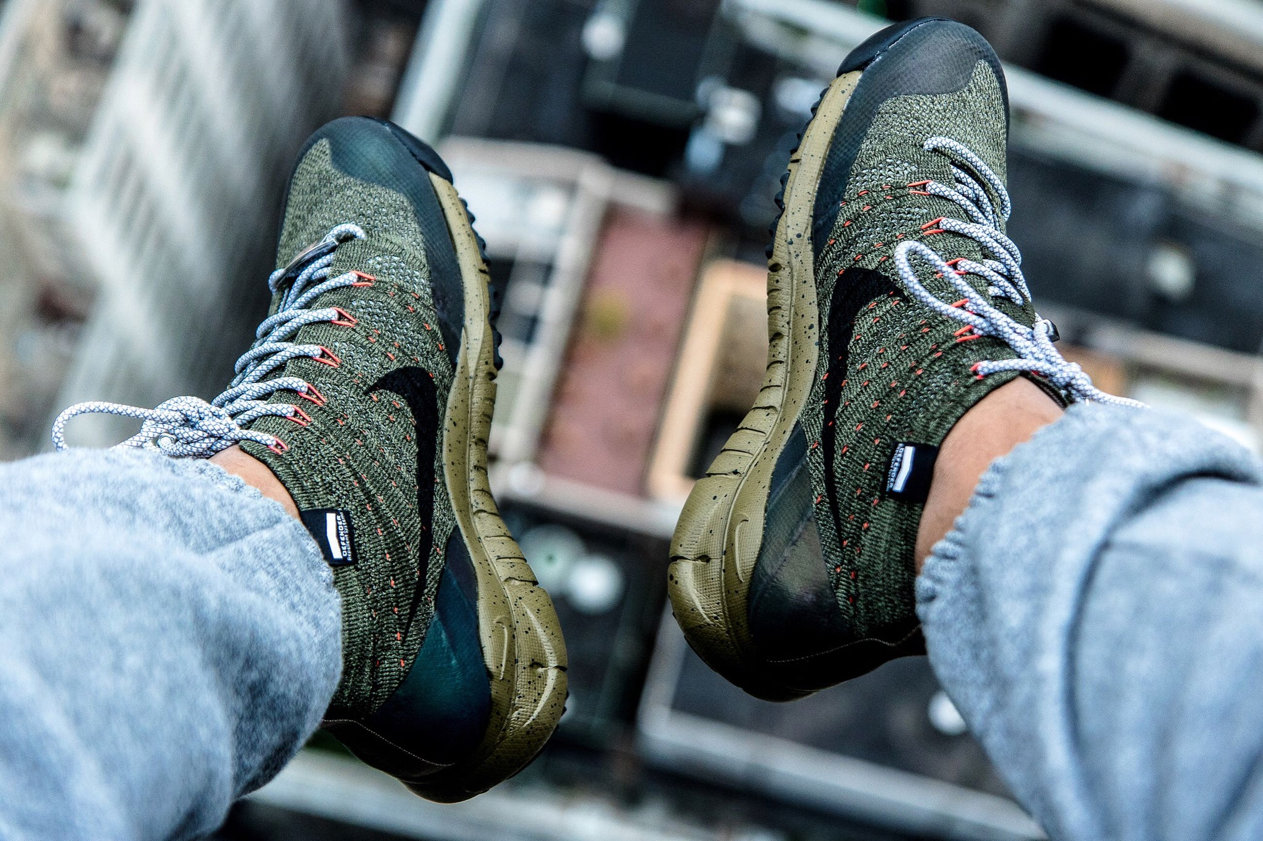 low section, shoe, person, jeans, lifestyles, focus on foreground, footwear, standing, men, fashion, casual clothing, close-up, leisure activity, selective focus, canvas shoe, personal perspective, human foot