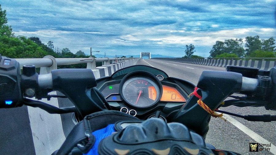 The world has more to offer than you might think 🇮🇳 Transportation Mode Of Transport Land Vehicle Day Speedometer Road Outdoors Real People Sky Human Body Part One Person Close-up One Man Only People Only Men Thunderstorm Wanderlust Motorcycle Photography Eyeemphotography Nomad EyeEm Photography Travelgrams Highwayphotography Beauty In Nature Traveldiary2017