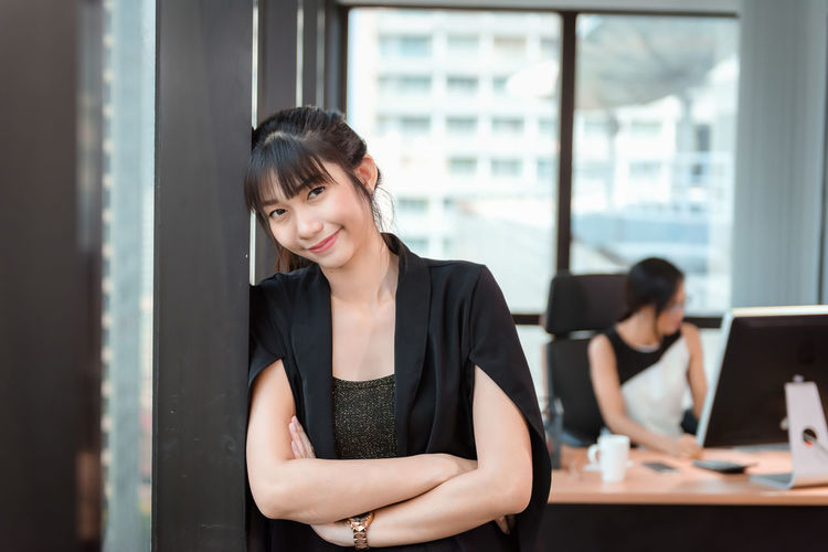 Portrait of Beautiful Attractive Business Woman Standing Beside Windows Frame in Modern Office, Confident Asian Girl in Arms Crossed Posing While Looking at Camera. Occupation and Financial Concept Portrait Beautiful Attractive Business Standing Window Frame Modern Office Confidence  Asian  Girl Arms Crossed Posing Looking At Camera Occupation Women Businesswoman Business Person Smiling Adult Young Adult Table Working Indoors  Corporate Business Technology Emotion Young Women Front View Computer Wireless Technology Coworker
