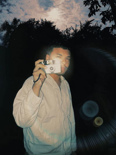 Portrait of man photographing camera