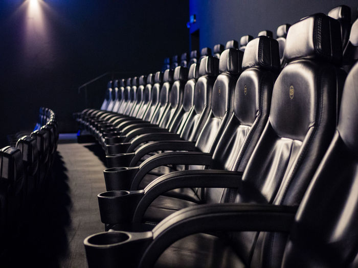 Empty black seats in movie theater