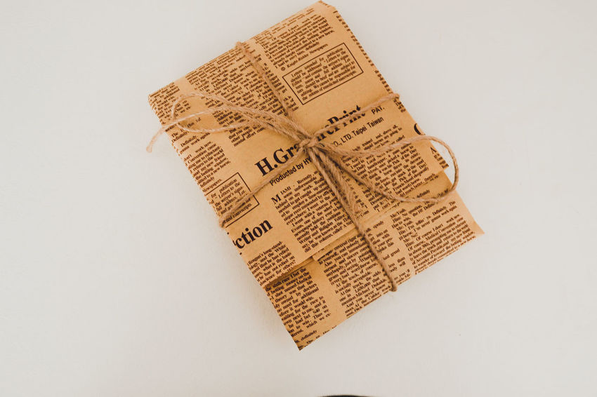 Close-up Data Newspaper No People Packaging Paper Premises White Background