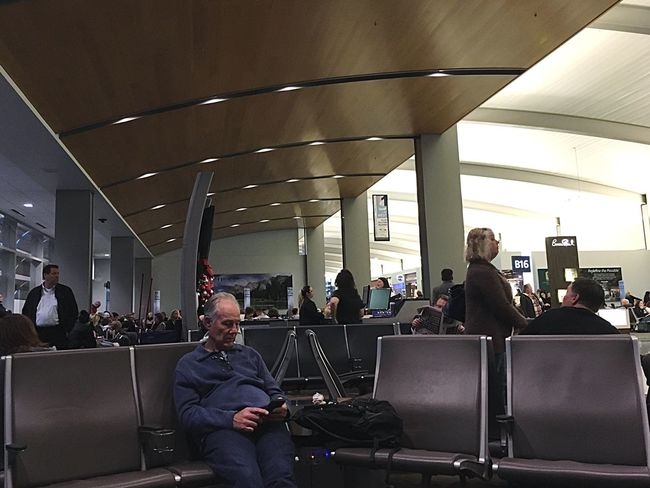 Waiting Game Laptop Technology Using Laptop Wireless Technology Large Group Of People Arts Culture And Entertainment Real People Connection Men Indoors  Dj People Adult Airport