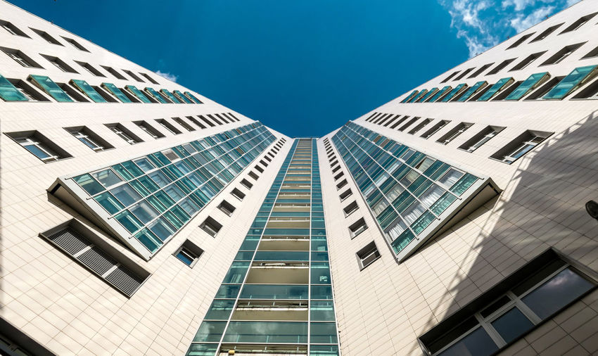 Sunny view of skyscraper external wall in moscow under blue sky in summer
