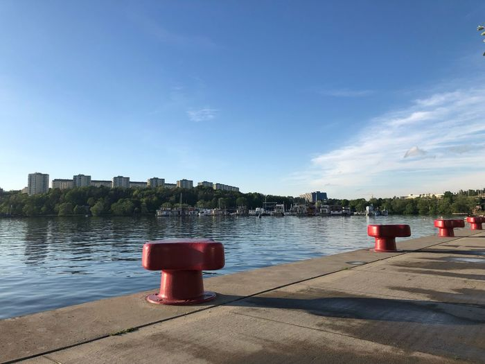 Stockholm, Sweden Bollards And Pier Bollard Bridge Summer Sunset Harbour Water Sky Nature Red Protection Safety Beach Outdoors Sea Sunlight