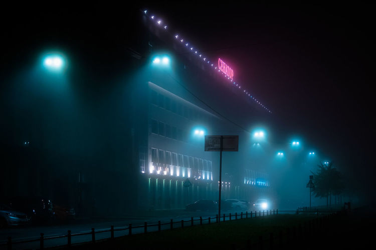 Illuminated Night Lighting Equipment Green Color Architecture No People Sign Fog Light Street Light Communication Nature Sky Guidance Built Structure Outdoors Street Low Angle View Electricity
