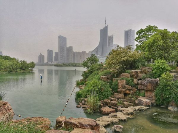 Hefei Swan Lake, Anhui, China. Skyscrapers and Nature Contrast Skyscraper Urban Skyline City Water Downtown District Modern Cityscape Tree Lake Outdoors Day No People Sky Hefei China Photos China Beauty Neighborhood Map