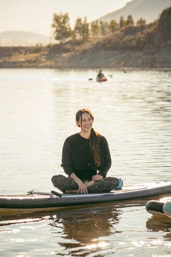 Portrait of man sitting in lake
