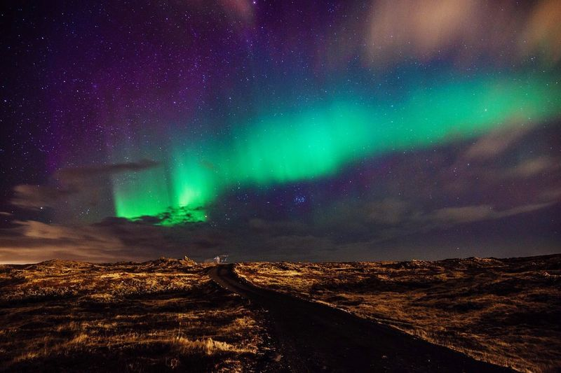 Geomagnetic Storm Over Landscape At Night