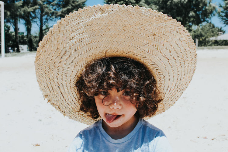 Boy wearing hat at beach
