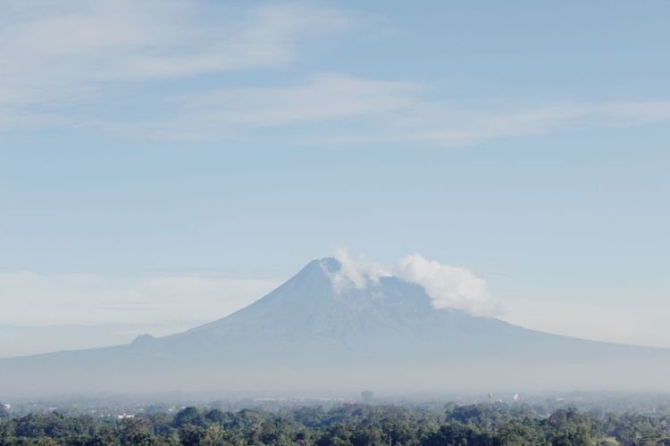 Scenic view of volcanic mountain against sky