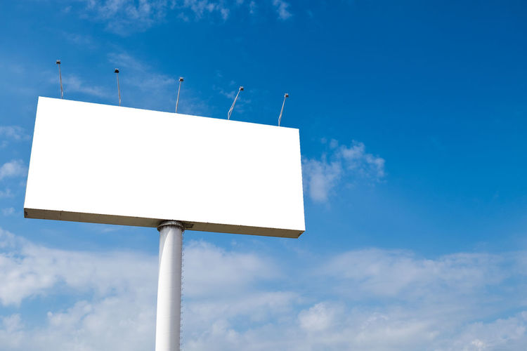Large billboards with a cloudy sky background