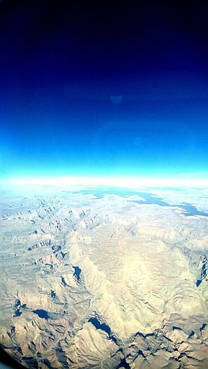Beauty In Nature Aerial View Scenics Nature Sky Blue Backgrounds Landscape Horizon Over Water Outdoors Airplane Day Natural Disaster No People Satellite View