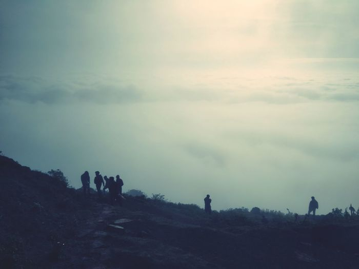 People on landscape against sky