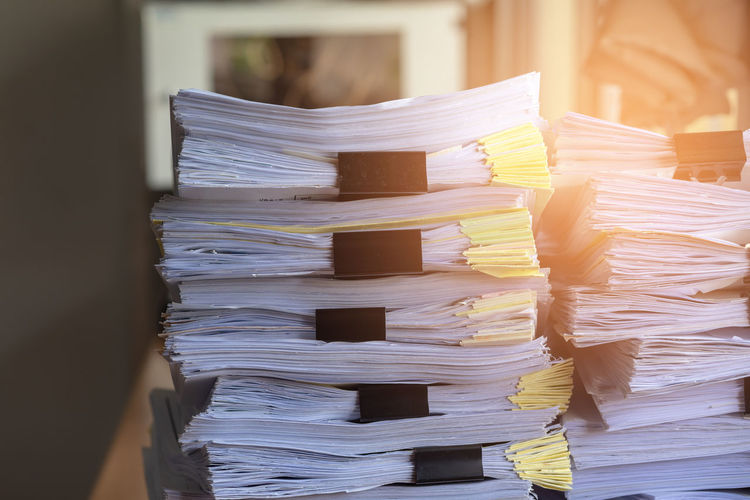 Close-up of documents stacked in office