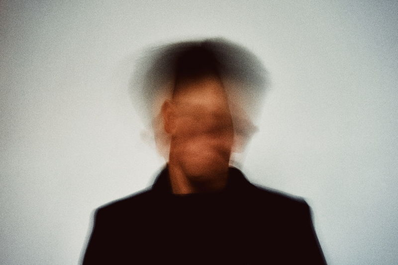 One Person Wall - Building Feature Blurred Motion Front View White Background Real People Indoors  Portrait Lifestyles Headshot Men Motion Standing Unrecognizable Person Human Face Studio Shot Waist Up Adult Leisure Activity Digital Composite Obscured Face Minimalism Modern