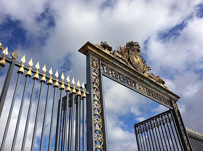 Low Angle View Of Gold Gate At Chateau De Versailles