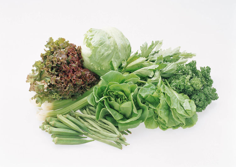 Directly above shot of vegetables against white background