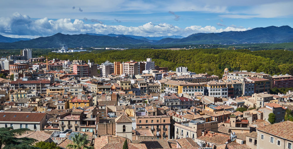 Town and mountains Vacations Girona Architecture Built Structure Cloud - Sky Cityscape Mountain Range Sky Day Mountain City Roof SPAIN Catalunya Nikonphotography Rooftop Building TOWNSCAPE