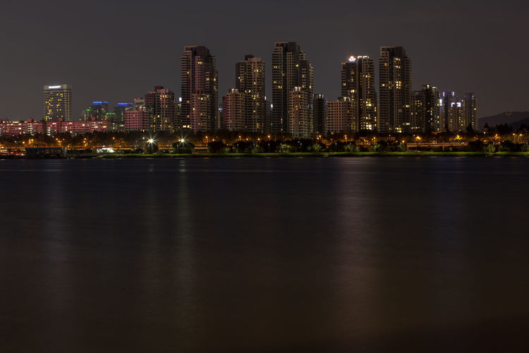 Scenic View Of City Skyline At Night