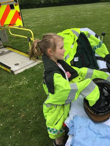 Child getting ready for ambulance work Medical 999 Not Looking At The Camera Kid Child Dress Up Ambulance Childhood Child Real People Day One Person Lifestyles Leisure Activity Females Girls Casual Clothing Innocence Playing Playground