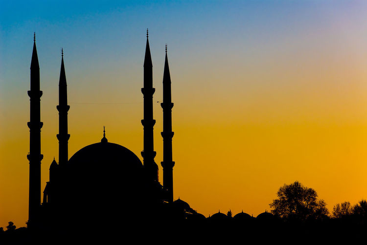 Silhouette of four legged minarets mosque Travel Turkey Minaret Four Legged Minaret Mosque Architecture Mosque The Past History Place Of Worship Dome Spirituality Outdoors Travel Destinations Orange Color No People Building Building Exterior Built Structure Belief Religion Architecture Sunset Sky Silhouette