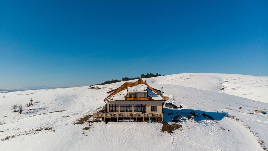 Snow Winter Cold Temperature Sky Blue Architecture Built Structure Mountain Nature Scenics - Nature Building Exterior Landscape Day Land Environment Hut Clear Sky Tranquility Building No People Outdoors Snowcapped Mountain Ski Resort
