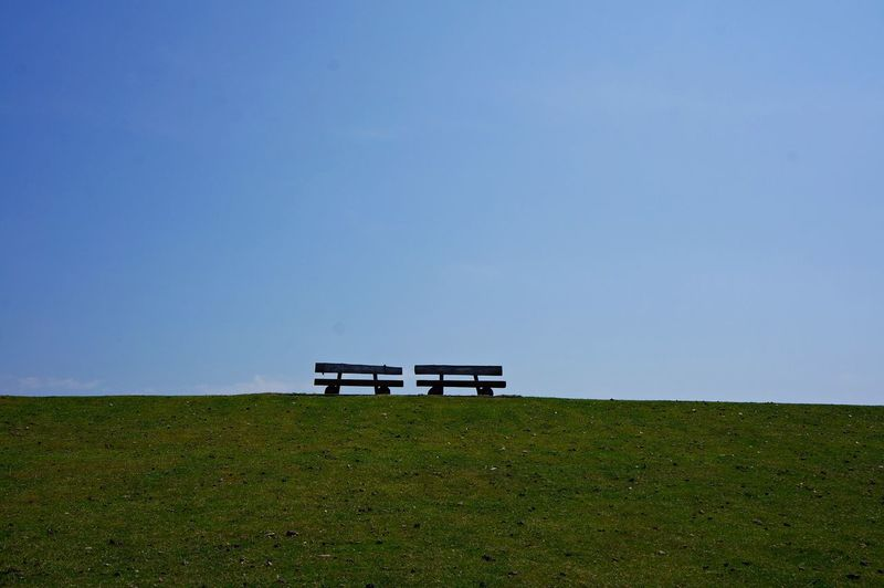 Bench On Field Against Clear Sky