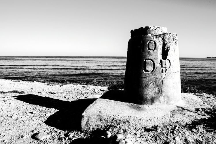 Beach Sea Sand Text Communication Horizon Over Water Day Outdoors Shadow Travel Destinations Water El Campello Blackandwhite Photography Monochrome Photography Horizon Over Sea Blackandwhite Nautical Signal Nautical Nautical Sign Shadows & Lights Shadow And Light Shadows Shadows And Backlighting Shadow Photography Shadows On The Floor