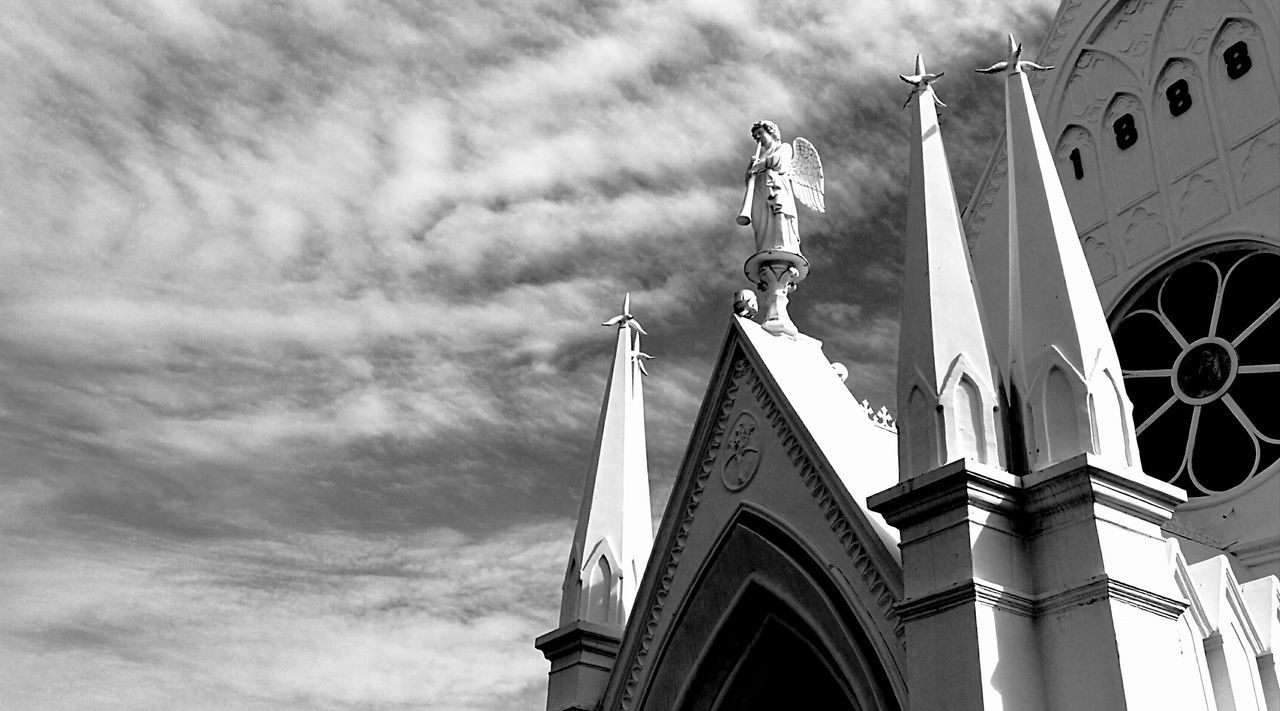 low angle view, architecture, built structure, day, no people, religion, outdoors, building exterior, sky, sculpture, statue