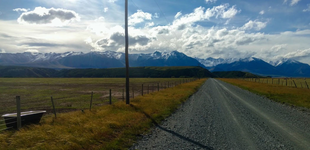 Farmland Mountain Mountain Range Newzealand New Zealand Travel Destinations Paddock Agriculture Scenic Outdoors Rural Scene Road Dirt Road No People Bath Tub Open Sky Fresh Air Beauty In Nature Environment Sky Landscape Scenics - Nature Nature High Angle View Stock Photo