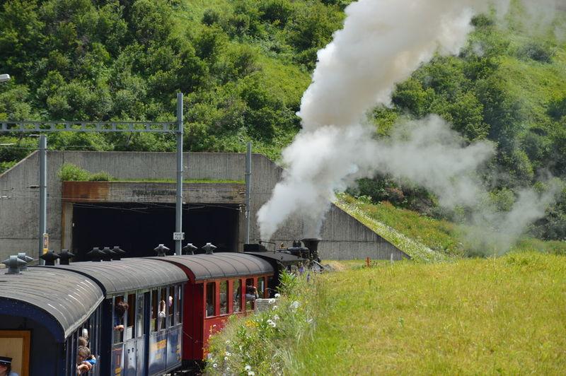 Passengers in steam train
